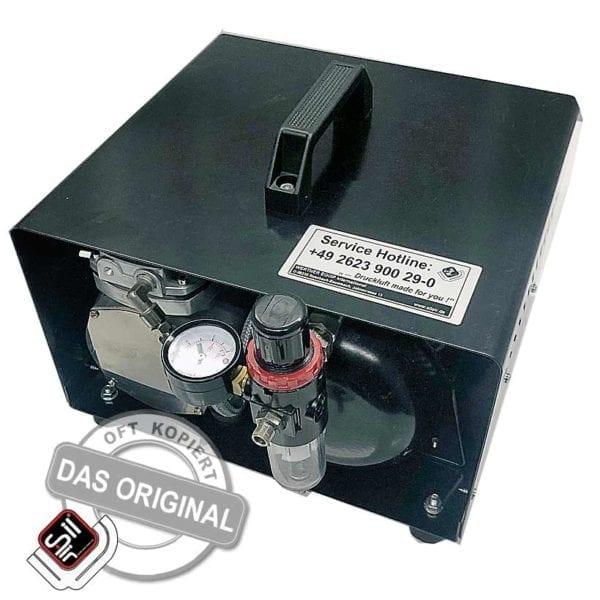 TC108 Kompressor das Original tragbar in einem Koffer mit eingebautem Drucklufttank und Druckmanometer schwarz
